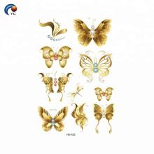 Tatouage papillon or et CMJN papillon
