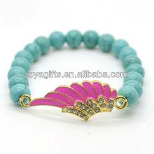 Türkis 8MM runde Perlen Stretch Edelstein Armband mit Diamante Legierung Flügel Stück