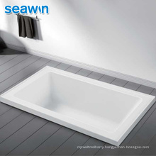 Seawin New Design Unique Clear Solid Surface Soaker Acrylic Sunken Bathtub Stand Up