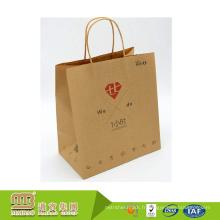 Guangzhou fournisseur professionnel marchandises personnalisées emballage sac de papier kraft marron avec poignée torsadée