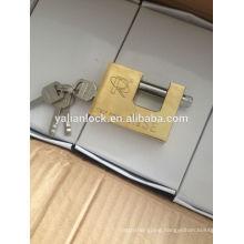 gold coated rectangular padlock fixed with vane key