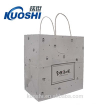 white printed paper bag with logo print