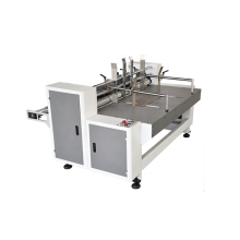 Automatic partition slotter machine for corrugated paperboard partitioner