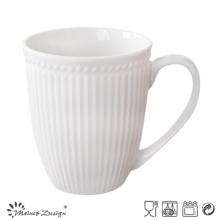 Taza de cerámica grabada en relieve de la raya y de los puntos