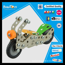 Kid assembling metal bricks toy motorcycle