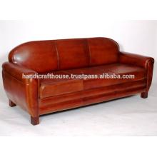 Hermoso sofá y silla de cuero marrón oscuro