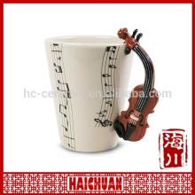 Taza del instrumento musical con la manija