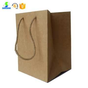 Shopping bag in carta kraft con manico