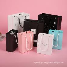 Manufacturer custom imprint logo vertical packaging bag low cost paper bag with rope handle