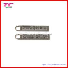 Tirador de cremallera de metal de níquel antiguo en relieve para accesorio de prenda