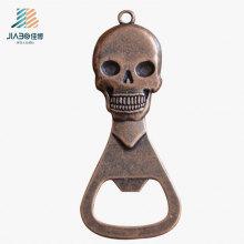 Modifique para requisitos particulares el abrebotellas del metal del regalo de la promoción del bronce de la fundición con el logotipo del cráneo