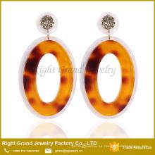 Diseñador Inspirado Pendientes Moda Tanishq Pendientes Precio gota Donut UV Pendientes de acrílico para mujer joyería