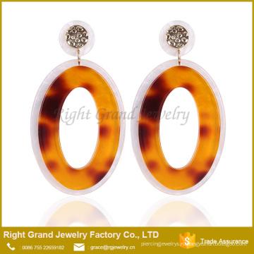 Дизайнера вдохновили серьги модные Tanishq серьги падение цен бублика УФ акриловые серьги для женщины ювелирные изделия