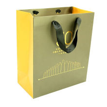 High Quality White art paper bag matt laminated finished with gold stamping printing shopping package biodegradble bags