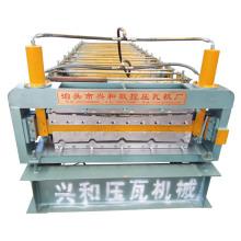Machine à formage de rouleaux à double couche pour feuille de toit roulant