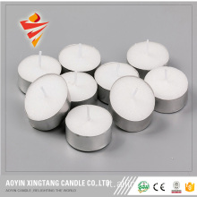 Candela in tealight colorata senza profumo da 23 g