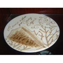 Keramische runde Platte mit handgemaltem Muster