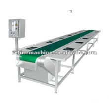 asparagus peeling and conveying machine