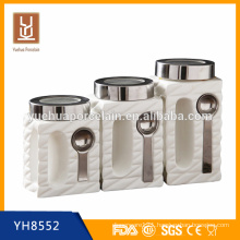 white ceramic food storage canisters set with spoon