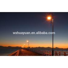 Tubular steel lamp post fitting bridge