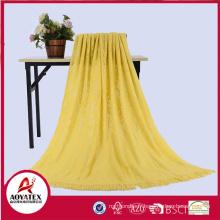 Couverture tricotée 100% acrylique de couleur unie avec gland