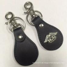 Kundenspezifisches schwarzes Leder Keychain mit kundenspezifischer Ikone