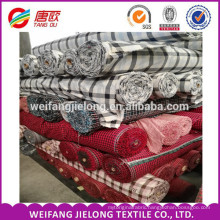 wholesale stock 2015 in China most popular weifang shandong 100% cotton shirting plaid flannel fabric