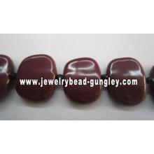 Hermosos abalorios artesanales de cerámicas cuadrado