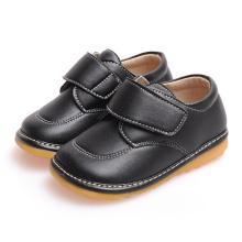 Feste schwarze Baby-Kleinkind-Schuhe weiche echtes Leder-Schuhe