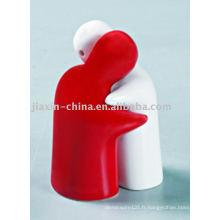 récipient de sel et de poivre en céramique de couleur blanche et rouge