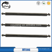 Short steel tension gas spring with protective sleeve