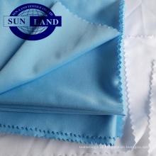 A camisa 100% do poliéster ostenta a tela do bloqueio do microfiber para o sportswear