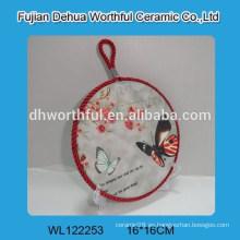 Sostenedores populares del pote de cerámica con la forma de la mariposa