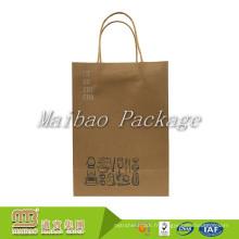 L'aliment fait sur commande de restaurant d'impression sortent les sacs en papier bruns de poignée tordue avec le logo