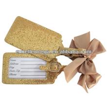 Étiquette à bagage plaqué or