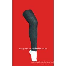Calentadores de pierna rayados de las mujeres