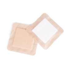 Self-adhesive high absorbent wound care foam dressing