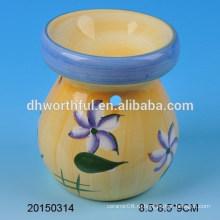 Желтая домашняя керамическая горелка с цветочным дизайном