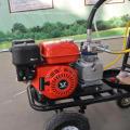 Machine de marquage de lignes routières par pulvérisation à froid sans air