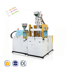 Machine rotatoire de moulage par injection de double couleur