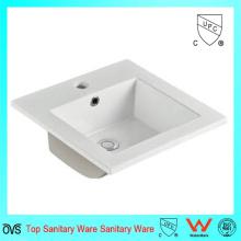 Lavabo y fregadero del gabinete de cerámica del cuarto de baño