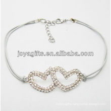 White wire diamante double heart alloy woven bracelet