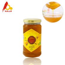 Raw polyflower honey with glass jar