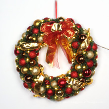 Couronne décorative de Noël avec arc rouge