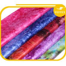 Alibaba chine différentes sortes de tissu africain guinée brocade bazin femmes porter garmens pour la fête de mariage