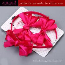 Ornamento del pelo con el arco de la cinta para las muchachas