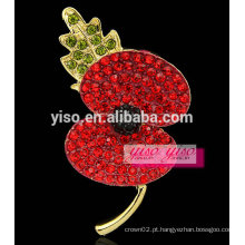 Broche de flor vermelha e folha verde