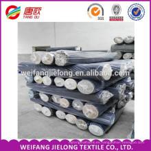 Un grado 100% algodón para prendas de mezclilla stock lote de tela acciones de tela de mezclilla