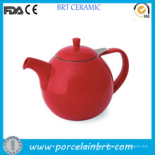 Théière en céramique émaillée rouge avec infuseur