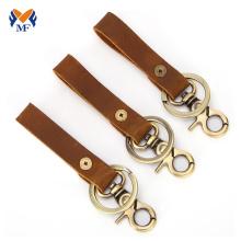 Porte-clés vintage en cuir avec lanière et clip